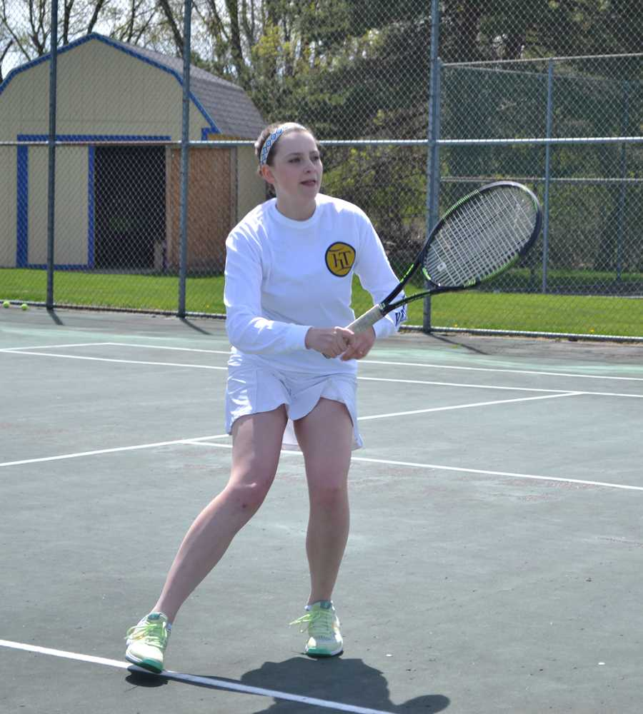 Senior Hannah Vogelsang mid-swing at a tennis practice.