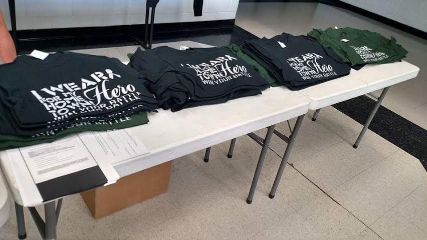 T-shirts+lined+up+in+the+Haslett+High+School+cafeteria+were+a+chance+for+people+to+show+their+support+for+the+Bauer+family.