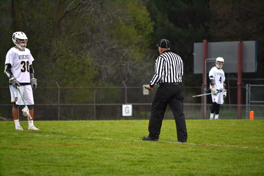 A referee explains a call to Williamston junior Logan Fennech during a home game between Haslett-Williamston and Holt, April 26